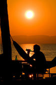 Drinking a Beer at Sunset — Stock Photo