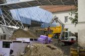 Grävare på byggarbetsplats — Stockfoto