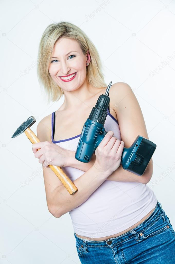 Blonde woman with hammer and screwdriver in her hands — Stock Photo #19593373
