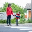 Mother and Son by the Crosswalk - Stock Photo