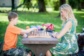 Woman playing Chess with her Son — Stock Photo
