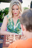 Thinking Woman playing Chess — Stock Photo