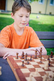 Boy play Chess with Concentration — Stock Photo