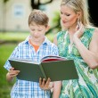 Mother and Son looking into a Book — Stock Photo
