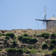Stock Photo: Obsolete Windmill in Naxos