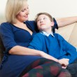 Mother and Son on a Couch — Stock Photo