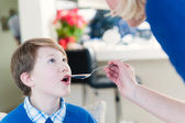 Mother give Medicine to Son — Stock Photo