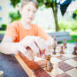 Boy moves piece in chess — Stock Photo