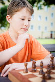Thinking Boy in a Chess Game — Stock Photo