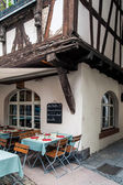 Bistro by a half-timbered house — Stock Photo