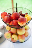 Basket full with Apples and Peaches — Stock Photo