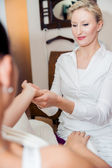 Hand massage by a blonde therapist — Stock Photo