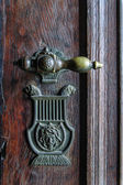 Vintage doorknob on antique door — Stock Photo