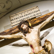 Jesus Christ crucifixion inside of an abbey — Stock Photo #44243411