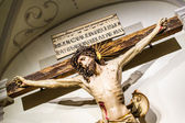 Jesus Christ crucifixion inside of an abbey — Stock Photo