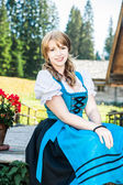 Blonde Woman in traditional austrian clothes — Stock Photo