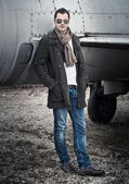 Man with Scarf standing by a Plane — Stock Photo