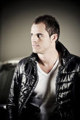 Handsome guy with leather jacket — Stock Photo