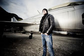 Handsome Man and his fighter plane — Stock Photo