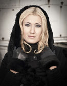 young woman wearing warm black coat — Stock Photo