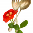 Spoon and fork with flower — Stock Photo