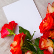 Orange roses and blank card — Stock Photo