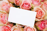 Bouquet of pink roses in basketwith greeting card — Stock Photo