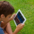Stock Photo: Boy holding tablet PC