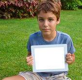 Boy showing tablet PC — Stock Photo