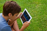 Boy holding tablet PC — Foto de Stock