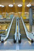 Metal and glass escalator — Stockfoto