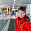 Boy in airport - Stock Photo