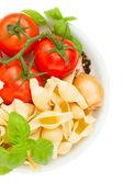 Raw italian pasta in plate — Stock Photo
