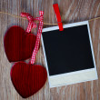 Instant photo and two hearts — Stock Photo