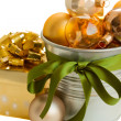 Christmas decorations in pot and gift box — Stock Photo