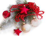Fir tree branch with christmas decorations — Stock Photo