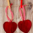 Two hanging hearts — 图库照片