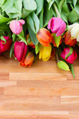 Spring tulips on wooden table — Стоковое фото