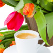 Cup of coffee with tulips — Stock Photo