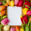 Stock Photo: Tulips on wooden table