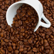 Stock Photo: Cup with raw coffee beans