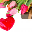 Heart shaped candle and tulips — Stock fotografie