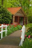 Hut in a garden — Stock Photo