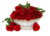 Red roses in basket — Stockfoto