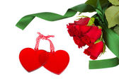 Two glass hearts with red roses — Stock Photo