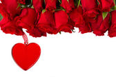 Red roses with hanging heart — Stock Photo