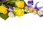 Yellow roses with quail eggs and ribbon — Stock Photo