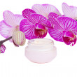 Moisturizer cream and orchid flower — Stockfoto