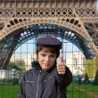 Happy teenager kid on front of Eiffel Tower, Paris — Stock Photo #19692303