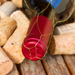 Red  wine bottle and corks — Stock Photo